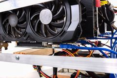 Cryptocurrency bitcoin ethereum altcoin graphic card miner minin. G rig. Home made crypto currency mining equipement in aluminium case with motherboard, graphic Royalty Free Stock Image