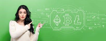 Cryptocurrency, Bitcoin -, Ethereum, Litecoin z młodą kobietą fotografia royalty free