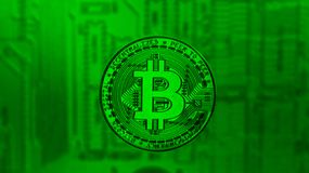 Bronze Bitcoin over pc motherboard in green tint stock photography