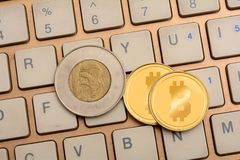 Cryptocurrency Bitcoin on Keyboard close up Stock Images