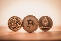 Cryptocurrency bitcoin, litecoins, ethereum rocznika retro filtr Obrazy Stock