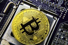 Cryptocurrency Bitcoin On The Motherboard. Gold Coin. Virtual Currency. stock photography