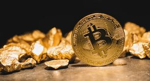 cryptocurrency Bitcoin and mound of gold nuggets - Business concept image royalty free stock images