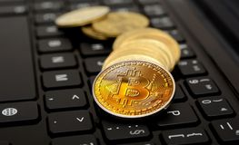 Cryptocurrency Bitcoin Stack on Keyboard closeup Stock Photo