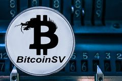 Cryptocurrency Bitcoin SV da moeda e números do arithmometer BSV imagens de stock royalty free