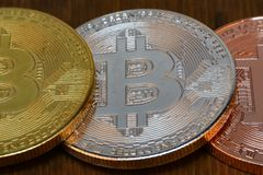 Bitcoins are on the wooden table. Cryptocurrency. Bitcoins are on the wooden table royalty free stock images