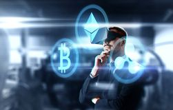 Cryptocurrency and businessman in virtual headset. Cryptocurrency, financial technology and business concept - businessman in virtual reality headset with stock image