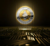 Cryptocurrency And Circuit Board. A ethereum cryptocurrency hologram in gold and silver physical coin form hovvering over a computer circuit board- 3D render Stock Images
