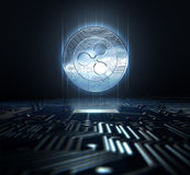 Cryptocurrency And Circuit Board. A ripple cryptocurrency hologram coin form hovvering over a computer circuit board- 3D render Stock Photo