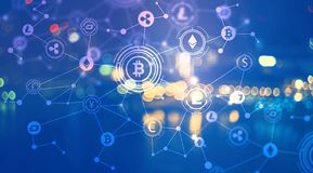 Cryptocurrency with city lights at night Stock Photo
