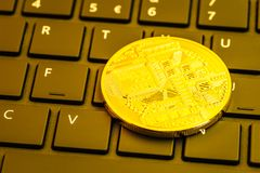 Cryptocurrency coin on computer keyboard royalty free stock images