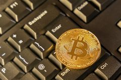 Cryptocurrency coin on top of computer keyboard at background, cryptocurrency accepting for payment and finance concept.  royalty free stock image