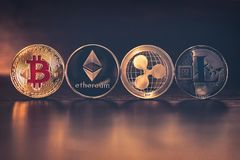 TOP of Cryptocurrencies. Bitcoin, Ethereum, Ripple, Litecoin on brown wood. Cryptocurrency coins - Bitcoin BTC, Ethereum ETH, RippleXRP, tecoin LTC on brown wood stock photography