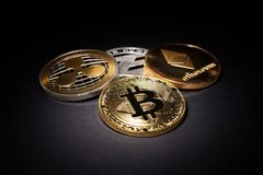 Cryptocurrency Coins: Bitcoin, Litecoin, Ethereum, Ripple Stock Image