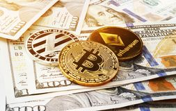 Cryptocurrency coins on a dollar bills. Crypto exchange trading. Cryptocurrency coins on a dollar bills. Crypto exchange trading concept royalty free stock photo