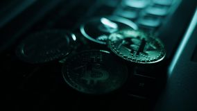 Cryptocurrency coins - gold Bitcoins, Ethereum and litecoin on the keyboard.
