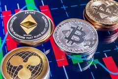 Cryptocurrency coins over tablet screen Royalty Free Stock Photo