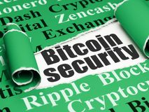 Cryptocurrency concept: black text Bitcoin Security under the piece of  torn paper. Cryptocurrency concept: black text Bitcoin Security under the curled piece of Stock Photos