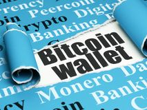 Cryptocurrency concept: black text Bitcoin Wallet under the piece of  torn paper. Cryptocurrency concept: black text Bitcoin Wallet under the curled piece of Royalty Free Stock Photo