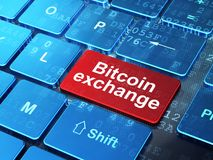 Cryptocurrency concept: Bitcoin Exchange on computer keyboard background. Cryptocurrency concept: computer keyboard with word Bitcoin Exchange on enter button Royalty Free Stock Image