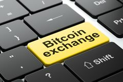 Cryptocurrency concept: Bitcoin Exchange on computer keyboard background. Cryptocurrency concept: computer keyboard with word Bitcoin Exchange, selected focus on Royalty Free Stock Images