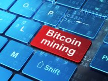 Cryptocurrency concept: Bitcoin Mining on computer keyboard background. Cryptocurrency concept: computer keyboard with word Bitcoin Mining on enter button Royalty Free Stock Photo