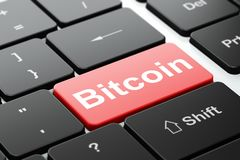 Cryptocurrency concept: Bitcoin on computer keyboard background. Cryptocurrency concept: computer keyboard with word Bitcoin, selected focus on enter button Royalty Free Stock Image