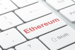 Cryptocurrency concept: Ethereum on computer keyboard background. Cryptocurrency concept: computer keyboard with word Ethereum, selected focus on enter button Stock Photography