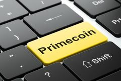 Cryptocurrency concept: Primecoin on computer keyboard background. Cryptocurrency concept: computer keyboard with word Primecoin, selected focus on enter button Royalty Free Stock Photography