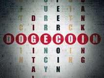 Cryptocurrency concept: Dogecoin in Crossword Puzzle. Cryptocurrency concept: Painted red word Dogecoin in solving Crossword Puzzle on Digital Data Paper Royalty Free Stock Photo