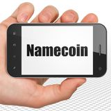 Cryptocurrency concept: Hand Holding Smartphone with Namecoin on display. Cryptocurrency concept: Hand Holding Smartphone with black text Namecoin on display, 3D Royalty Free Stock Image