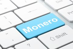 Cryptocurrency concept: Monero on computer keyboard background. Cryptocurrency concept: computer keyboard with word Monero, selected focus on enter button Royalty Free Stock Photography