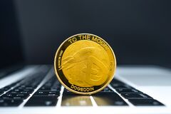 Free Cryptocurrency Concept Of Gold Dogecoin Coins On Keyboard Royalty Free Stock Images - 218637009