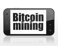 Cryptocurrency concept: Smartphone with Bitcoin Mining on display. Cryptocurrency concept: Smartphone with black text Bitcoin Mining on display, 3D rendering Stock Photography