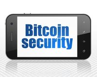 Cryptocurrency concept: Smartphone with Bitcoin Security on display. Cryptocurrency concept: Smartphone with blue text Bitcoin Security on display, 3D rendering Royalty Free Stock Image