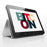 Cryptocurrency concept: Tablet Computer with Bitcoin on  display Royalty Free Stock Images