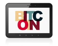 Cryptocurrency concept: Tablet Computer with Bitcoin on  display. Cryptocurrency concept: Tablet Computer with Painted multicolor text Bitcoin on display, 3D Royalty Free Stock Images