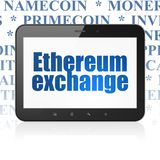Cryptocurrency concept: Tablet Computer with Ethereum Exchange on display. Cryptocurrency concept: Tablet Computer with  blue text Ethereum Exchange on display Royalty Free Stock Photo