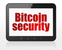 Cryptocurrency concept: Tablet Pc Computer with Bitcoin Security on display. Cryptocurrency concept: Tablet Pc Computer with red text Bitcoin Security on display Stock Photo