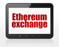 Cryptocurrency concept: Tablet Pc Computer with Ethereum Exchange on display. Cryptocurrency concept: Tablet Pc Computer with red text Ethereum Exchange on Royalty Free Stock Photography