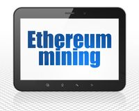 Cryptocurrency concept: Tablet Pc Computer with Ethereum Mining on display. Cryptocurrency concept: Tablet Pc Computer with blue text Ethereum Mining on display Royalty Free Stock Images