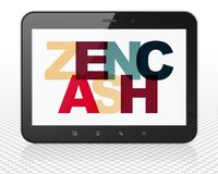 Cryptocurrency concept: Tablet Pc Computer with Zencash on  display. Cryptocurrency concept: Tablet Pc Computer with Painted multicolor text Zencash on display Royalty Free Stock Image