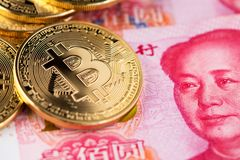 Cryptocurrency digital currency close up renminbi yuan bitcoin china. Bitcoin and banknotes of one hundred yuan. Background with crypto bitcoin and China yuan royalty free stock image