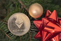 Cryptocurrency Ethereum on the branches of spruce royalty free stock photos