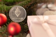 Cryptocurrency Ethereum on the branches of spruce. royalty free stock photography