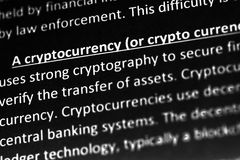 Cryptocurrency explanation or description in dictionary or article. Close up with focus on cryptocurrency. Cryptocurrency explanation or description in royalty free stock image