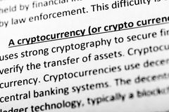 Cryptocurrency explanation or description in dictionary or article. Close up with focus on cryptocurrency. Cryptocurrency explanation or description in stock photos