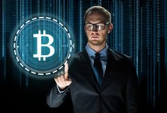Close up of businessman with bitcoin hologram Stock Photos