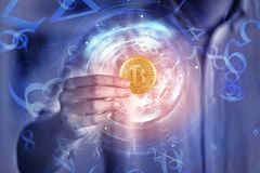 Cryptocurrency and finance concept. Hand holding abstract digital golden bitcoin on blurry background. Cryptocurrency and finance concept. Double exposure Stock Photography