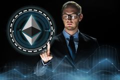 Businessman hand with ethereum hologram over black Royalty Free Stock Photos